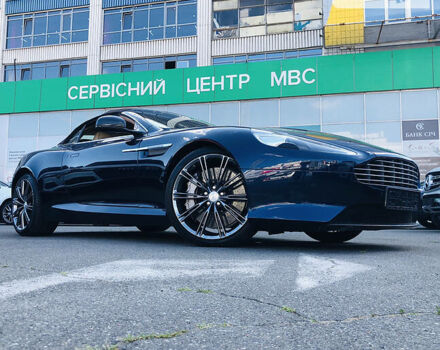 Синий Астон Мартин ДБ9, объемом двигателя 5.9 л и пробегом 15 тыс. км за 125000 $, фото 1 на Automoto.ua