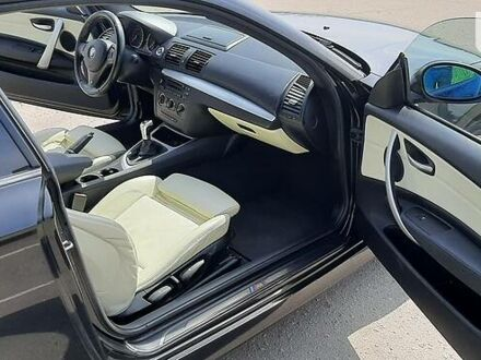 Черный БМВ 118, объемом двигателя 2 л и пробегом 238 тыс. км за 8800 $, фото 1 на Automoto.ua