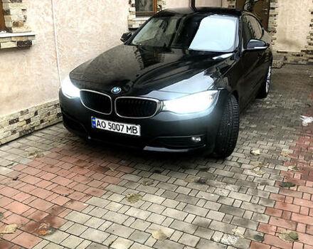 Черный БМВ 318, объемом двигателя 2 л и пробегом 165 тыс. км за 24500 $, фото 1 на Automoto.ua