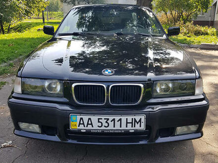 Чорний БМВ 323, об'ємом двигуна 2.5 л та пробігом 275 тис. км за 6800 $, фото 1 на Automoto.ua