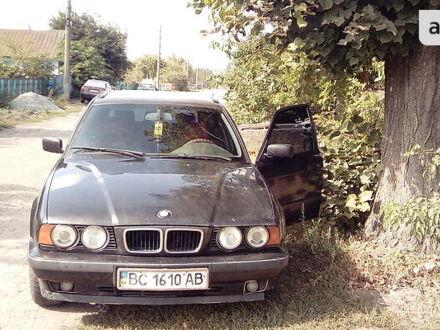 Черный БМВ 518, объемом двигателя 1.8 л и пробегом 373 тыс. км за 4000 $, фото 1 на Automoto.ua