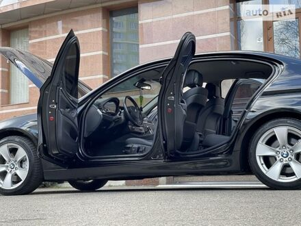 Чорний БМВ 520, об'ємом двигуна 2 л та пробігом 192 тис. км за 17599 $, фото 1 на Automoto.ua
