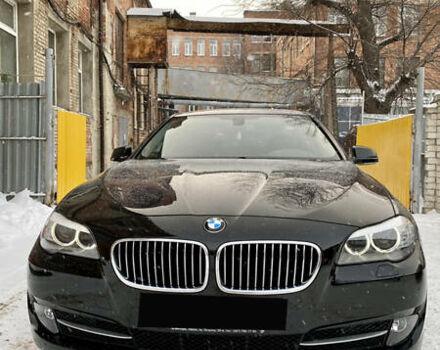 Черный БМВ 520, объемом двигателя 2 л и пробегом 100 тыс. км за 22700 $, фото 1 на Automoto.ua