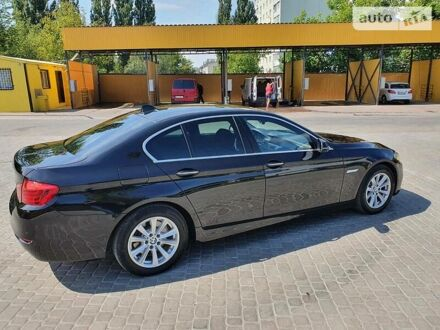 Чорний БМВ 520, об'ємом двигуна 2 л та пробігом 146 тис. км за 25100 $, фото 1 на Automoto.ua