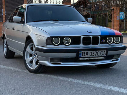 Серый БМВ 520, объемом двигателя 2.5 л и пробегом 385 тыс. км за 4100 $, фото 1 на Automoto.ua