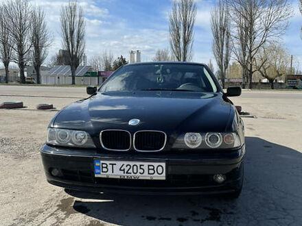 Черный БМВ 523, объемом двигателя 2.5 л и пробегом 395 тыс. км за 5600 $, фото 1 на Automoto.ua
