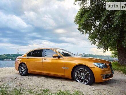 Жовтий БМВ 750, об'ємом двигуна 4.4 л та пробігом 140 тис. км за 21300 $, фото 1 на Automoto.ua