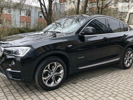 Черный БМВ Х4, объемом двигателя 2 л и пробегом 72 тыс. км за 36700 $, фото 1 на Automoto.ua