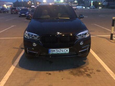 Черный БМВ Х5, объемом двигателя 3 л и пробегом 70 тыс. км за 37500 $, фото 1 на Automoto.ua