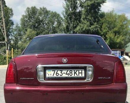 Красный Кадиллак ДеВиль, объемом двигателя 4.6 л и пробегом 133 тыс. км за 24999 $, фото 1 на Automoto.ua