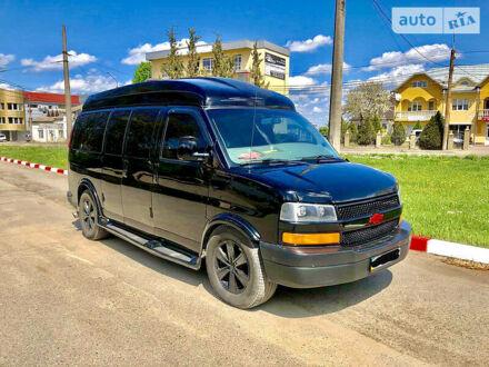 Черный Шевроле Express пас, объемом двигателя 5.3 л и пробегом 250 тыс. км за 25000 $, фото 1 на Automoto.ua
