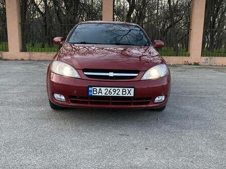 Красный Шевроле Лачетти, объемом двигателя 1.6 л и пробегом 143 тыс. км за 5500 $, фото 1 на Automoto.ua