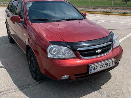 Красный Шевроле Лачетти, объемом двигателя 1.8 л и пробегом 255 тыс. км за 5500 $, фото 1 на Automoto.ua