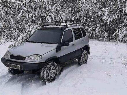 Серый Шевроле Нива, объемом двигателя 1.7 л и пробегом 777 тыс. км за 5000 $, фото 1 на Automoto.ua
