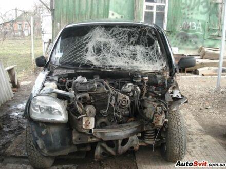 Серый Шевроле Нива, объемом двигателя 1.7 л и пробегом 70 тыс. км за 1 $, фото 1 на Automoto.ua