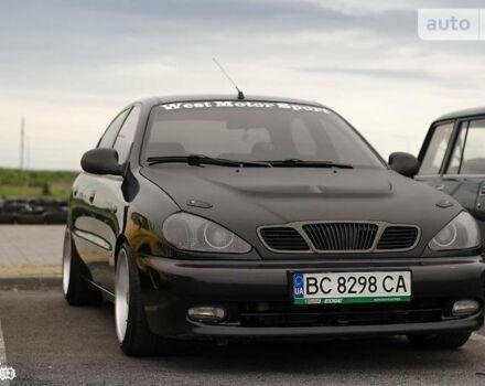 Черный Дэу Ланос, объемом двигателя 1.6 л и пробегом 140 тыс. км за 6500 $, фото 1 на Automoto.ua