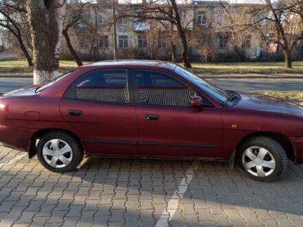 Красный Дэу Нубира, объемом двигателя 1.6 л и пробегом 190 тыс. км за 2500 $, фото 1 на Automoto.ua
