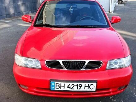 Красный Дэу Нубира, объемом двигателя 1.6 л и пробегом 166 тыс. км за 3100 $, фото 1 на Automoto.ua