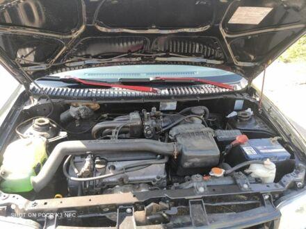 Черный Дайхатсу Куоре, объемом двигателя 1 л и пробегом 238 тыс. км за 3500 $, фото 1 на Automoto.ua