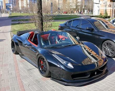 Черный Феррари 458 Италия, объемом двигателя 4.5 л и пробегом 15 тыс. км за 230000 $, фото 1 на Automoto.ua