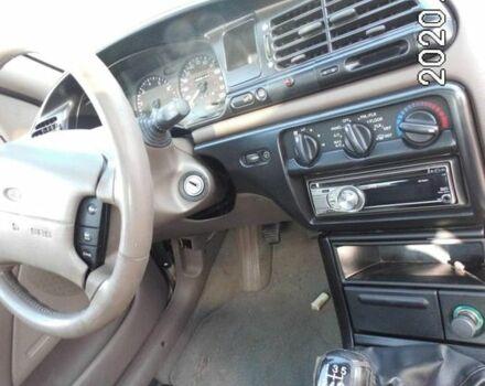 Бежевый Форд Контур, объемом двигателя 2 л и пробегом 100 тыс. км за 668 $, фото 1 на Automoto.ua