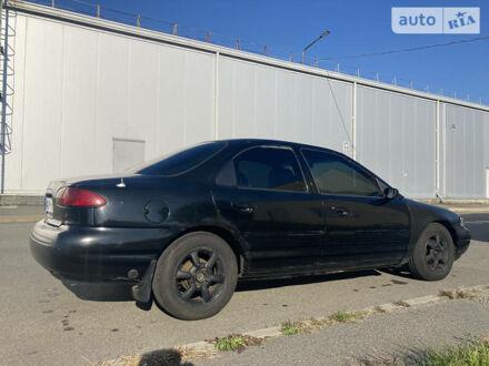 Черный Форд Контур, объемом двигателя 2 л и пробегом 299 тыс. км за 2100 $, фото 1 на Automoto.ua