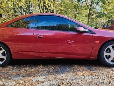 Красный Форд Кугар, объемом двигателя 2.5 л и пробегом 327 тыс. км за 4600 $, фото 1 на Automoto.ua