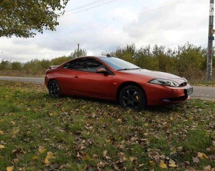 Красный Форд Кугар, объемом двигателя 2 л и пробегом 317 тыс. км за 5250 $, фото 1 на Automoto.ua