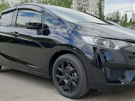 Чорний Хонда ФІТ, об'ємом двигуна 1.5 л та пробігом 79 тис. км за 10777 $, фото 1 на Automoto.ua