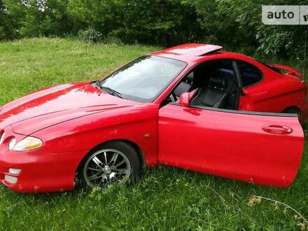 Красный Хендай Тибурон, объемом двигателя 2 л и пробегом 220 тыс. км за 4800 $, фото 1 на Automoto.ua