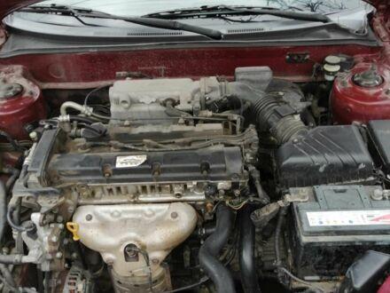 Красный Хендай Тибурон, объемом двигателя 2 л и пробегом 150 тыс. км за 7000 $, фото 1 на Automoto.ua