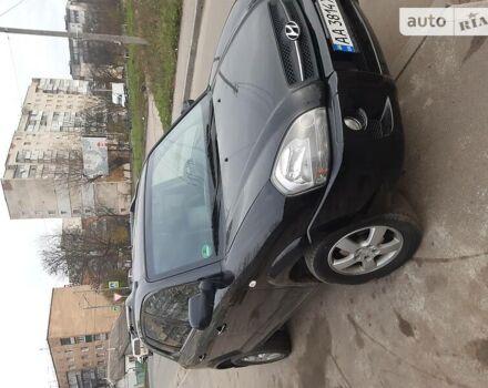 Черный Хендай Туксон, объемом двигателя 2 л и пробегом 290 тыс. км за 7600 $, фото 1 на Automoto.ua