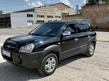 Черный Хендай Туксон, объемом двигателя 2 л и пробегом 149 тыс. км за 8700 $, фото 1 на Automoto.ua
