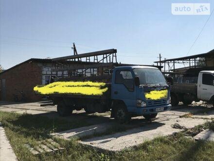 Синий Исузу НКР, объемом двигателя 4.6 л и пробегом 343 тыс. км за 10700 $, фото 1 на Automoto.ua