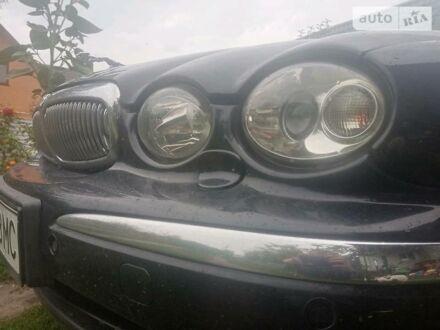 Черный Ягуар Х-Тайп, объемом двигателя 2.5 л и пробегом 226 тыс. км за 7500 $, фото 1 на Automoto.ua