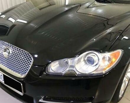 Черный Ягуар ХФ, объемом двигателя 3 л и пробегом 76 тыс. км за 21000 $, фото 1 на Automoto.ua