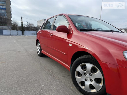 Красный Киа Черато, объемом двигателя 1.6 л и пробегом 204 тыс. км за 5000 $, фото 1 на Automoto.ua