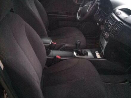 Красный Киа Маджентис, объемом двигателя 2 л и пробегом 150 тыс. км за 7000 $, фото 1 на Automoto.ua