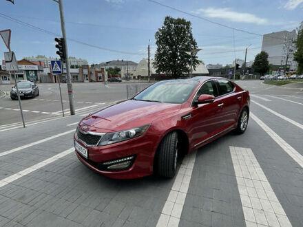 Червоний Кіа Оптіма, об'ємом двигуна 2 л та пробігом 160 тис. км за 13800 $, фото 1 на Automoto.ua