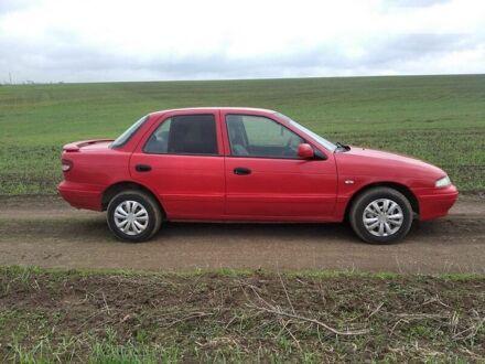 Красный Киа Сефия, объемом двигателя 1.6 л и пробегом 300 тыс. км за 2000 $, фото 1 на Automoto.ua