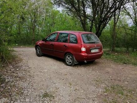 Красный Лада Калина, объемом двигателя 1.6 л и пробегом 120 тыс. км за 3400 $, фото 1 на Automoto.ua