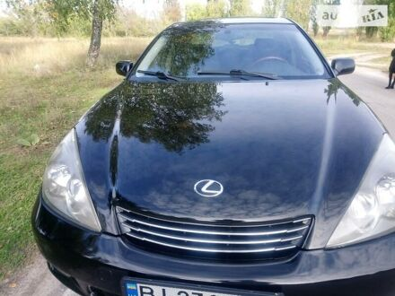 Черный Лексус ES 300, объемом двигателя 3 л и пробегом 220 тыс. км за 6890 $, фото 1 на Automoto.ua