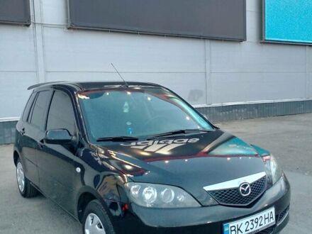 Черный Мазда 2, объемом двигателя 1.4 л и пробегом 200 тыс. км за 5000 $, фото 1 на Automoto.ua