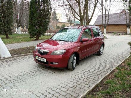 Красный Мазда 2, объемом двигателя 1.4 л и пробегом 141 тыс. км за 5400 $, фото 1 на Automoto.ua
