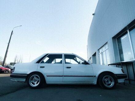 Білий Мазда 323, об'ємом двигуна 1.5 л та пробігом 120 тис. км за 0 $, фото 1 на Automoto.ua