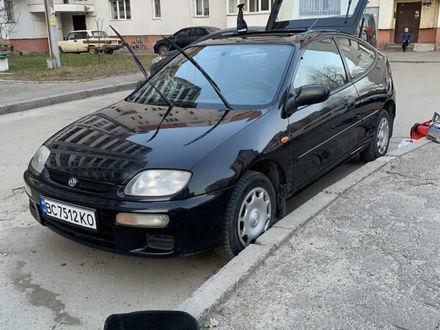 Черный Мазда 323, объемом двигателя 1.3 л и пробегом 263 тыс. км за 3100 $, фото 1 на Automoto.ua