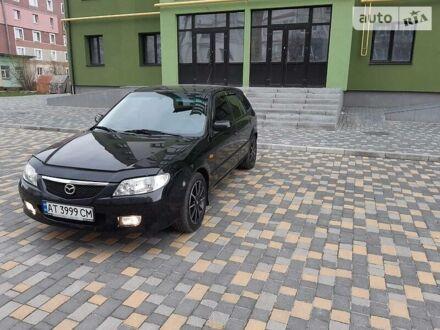 Черный Мазда 323, объемом двигателя 2 л и пробегом 258 тыс. км за 5000 $, фото 1 на Automoto.ua