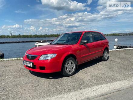 Красный Мазда 323, объемом двигателя 1.3 л и пробегом 301 тыс. км за 3300 $, фото 1 на Automoto.ua