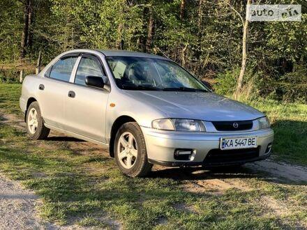 Серый Мазда 323, объемом двигателя 1.5 л и пробегом 236 тыс. км за 4200 $, фото 1 на Automoto.ua
