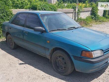 Синий Мазда 323, объемом двигателя 1.6 л и пробегом 330 тыс. км за 1990 $, фото 1 на Automoto.ua